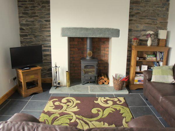 picture of sitting room, showing log burner
